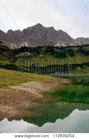 Mountain Lachenspitze with reflection in lake Traualpsee