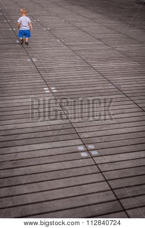 Little boy on a lonely walk