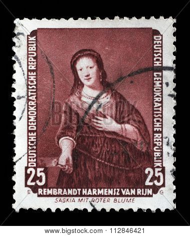 DDR - CIRCA 1957: A stamp printed in DDR shows the painting Saskia with red flower, by Rembrandt, from the series Famous Paintings from Dresden Gallery, circa 1957.