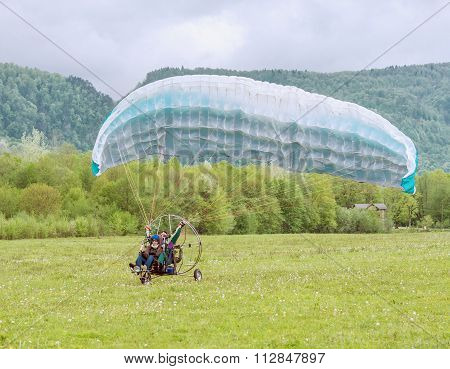 Taking Off The Paraglider.