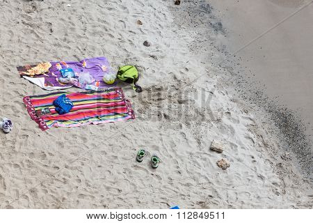 Top View Of Towels At Tsigrado Beach In Milos Island, Cyclades, Greece