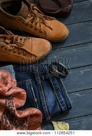 Women's Autumn Clothing And Accessories - Boots, Jeans, Scarf, Bag, On Dark Wood Surfaces, Vintage S