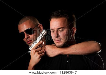 Hostage - A Dangerous Man With A Gun Kidnaping A Businessman