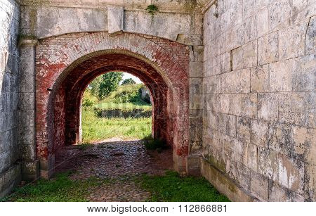 Old stone red arch in Daugavpils fortress, Latvia poster