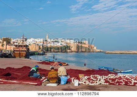 Fishermans Fixing Fishing Net In Rabat Fishing Port. Rabat, Morocco.