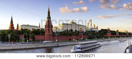 Moscow Kremlin at summer evening, Moscow-river and tourist pleasure boats, panorama, view from bridge poster