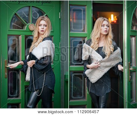 Charming young blonde woman with white fur posing in a green painted door frame. Sexy gorgeous girl