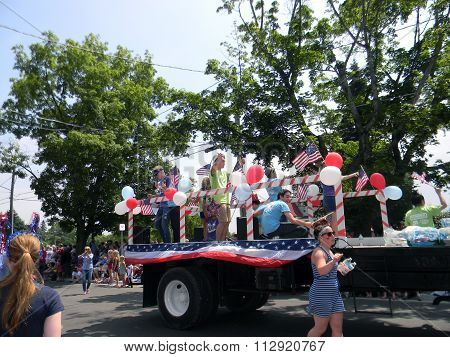 Young Americans Ride Truck in 4th of July Parade