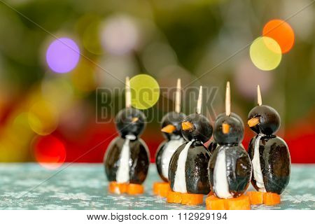 Penguins made with olives and cheese