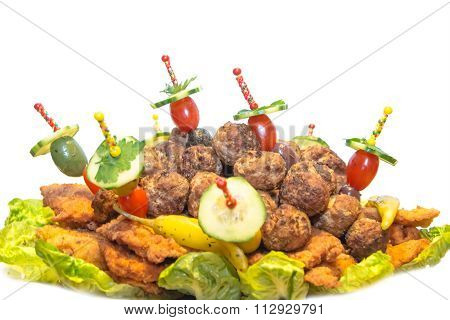 Festive plate with meatballs and schnitzel