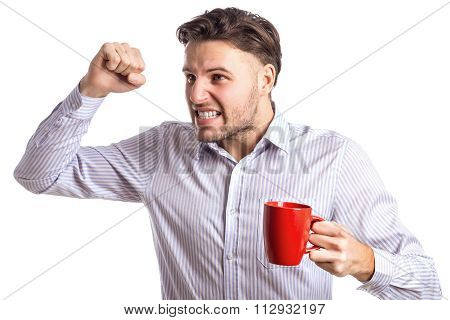 Handsome Angry Businessman Brandishing His Fist Holding Red Cup