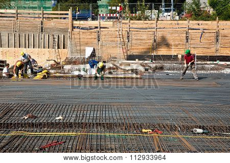 Workers Are Doing The Armoring At The Building Site