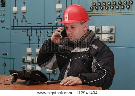 Technician Make Mobile Phone Call In The Power Plant Control Center