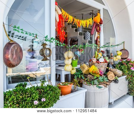 Traditional Greek shop with different food and taverna in Thira town