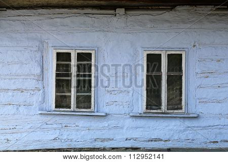Windows of old wooden cottage in the countryside