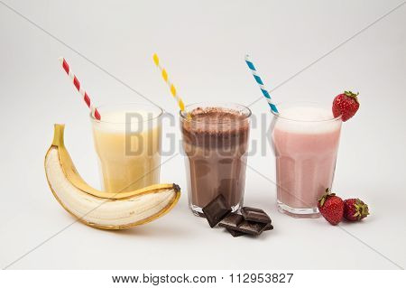 Fruits and Milkshakes on white background