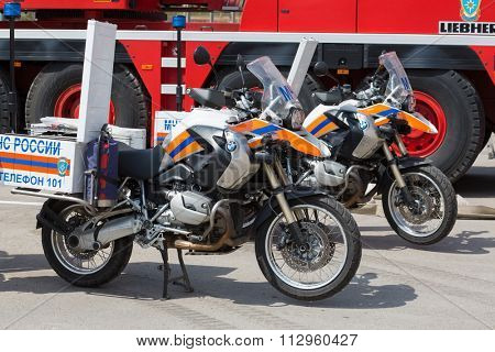 MOSCOW - MAY 29, 2015: Red fire-engine and two motorcycle with fire fighting equipmet