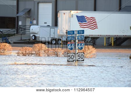 VALLEY PARK, MO/USA   JANUARY 1, 2016: Flood waters submerge highway signs in Valley Park, Missouri