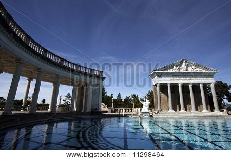 Ruins stand over the pool at Hearst Castle near San Simeon, California poster