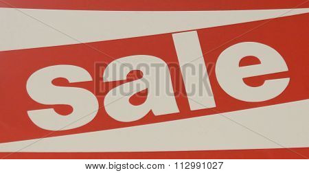 Red And White Sale Sign Indicating A Discount