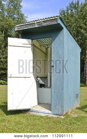 Open door to a working outhouse