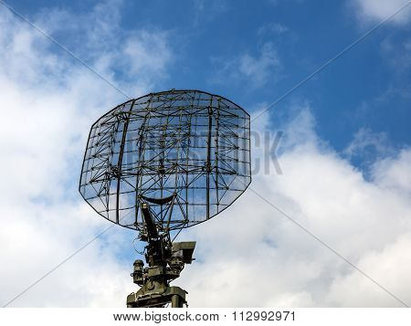 Military radar radio locator station antenna on background blue sky poster