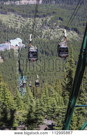 BANFF, ALBERTA, CANADA - JUNE 2015: The Banff Gondola carries 4 passengers per car up the shoulder of Sulphur Mountain just outside the resort town of Banff June 10, 2015.
