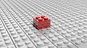 Connected white lego blocks with one red standing out, abstract background. poster