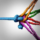 Connected group concept as many different ropes tied and linked together as an unbreakable chain as a community trust and faith metaphor for dependence and reliance on trusted partners for team and teamwork support and strength. poster