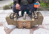 Close-up view of a shoeshine man with toolbox poster