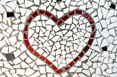 a red heart made with mosaic bits poster