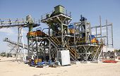A photo of an incomplete diamond mine washing and seperation plant poster
