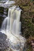 Sgwd Clun-Gwyn Falls waterfall. Pontneddfechan Vale of Neath Powys Wales United Kingdom winter. poster