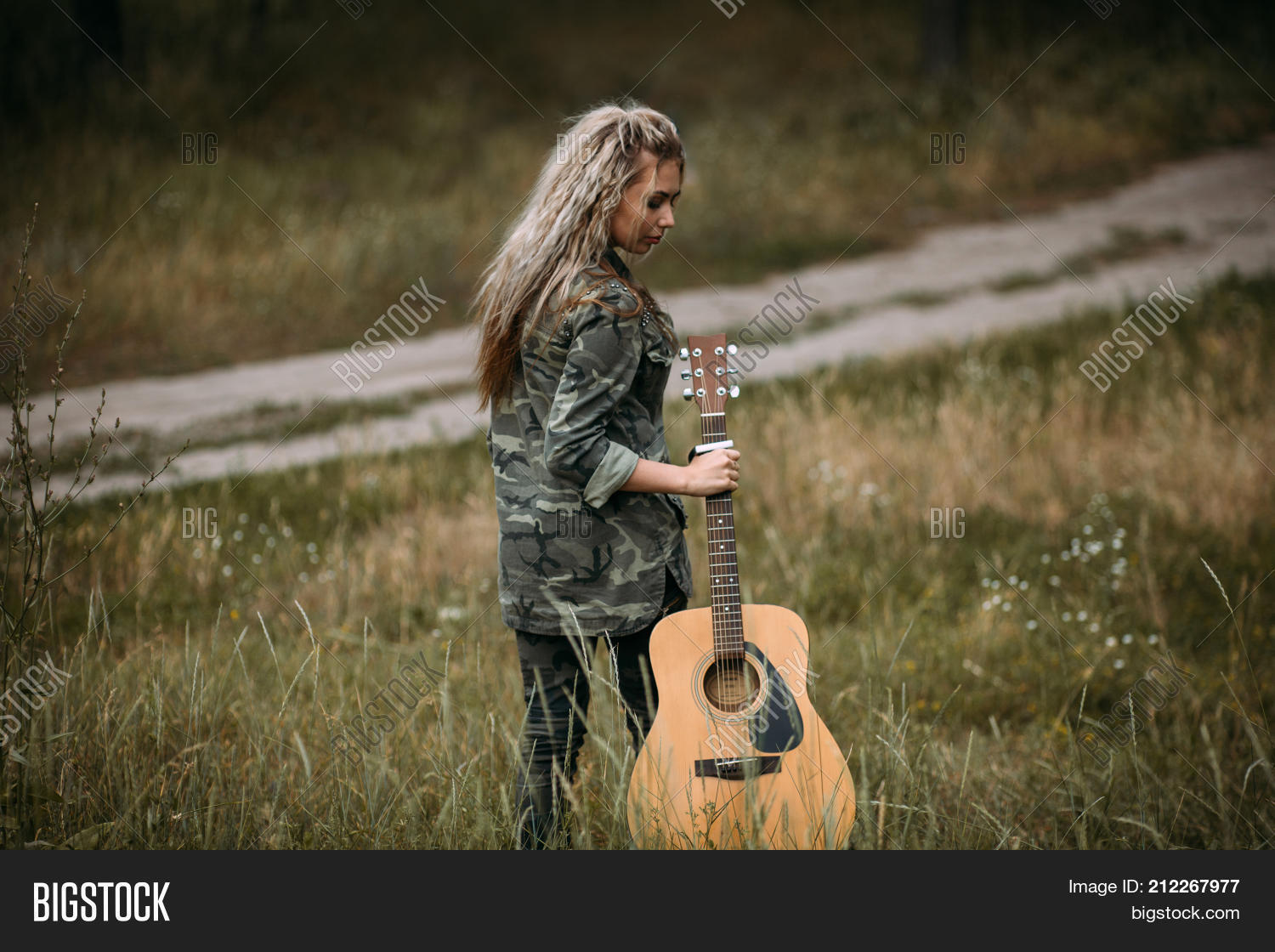 Pretty sad woman guitar nature fashion look concept unity with nature