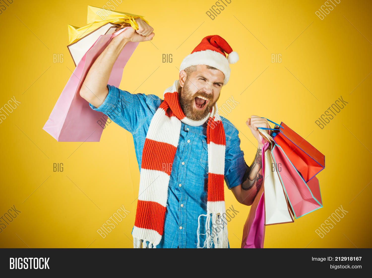faa151b6fd566 Christmas man hold shopping bags with winner gesture. Black friday sale  concept. Hipster shopper