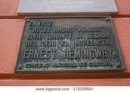 HAVANA, CUBA - DECEMBER 10 2016 - Hotel Ambos Mundos placard with the name of Ernest Hemingway. The Hotel Ambos Mundos (both worlds), opened in 1925, is a historic landmark in the center of the Cuban capital made famous by American writer Ernest Hemingway
