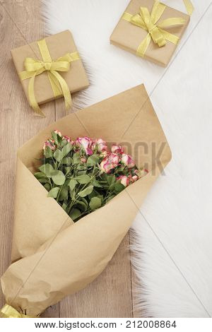 Large Luxury Bouquet Of Roses And Gifts On A Fur Carpet