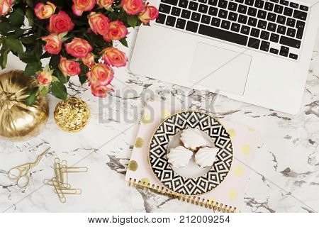 Feminine Workplace Concept. Freelance Workspace In Flat Lay Style With Laptop, Flowers, Golden Pinea