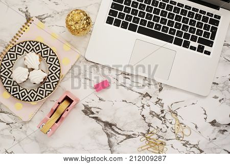 Feminine Workplace Concept. Freelance Workspace In Flat Lay Style With Laptop, Sweets, Golden Pineap