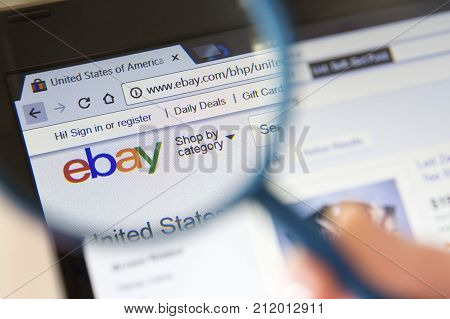 Paris France - October 19 2017 : Closeup of ebay website under a magnifying glass. eBay is an american multinational corporation and e-commerce company
