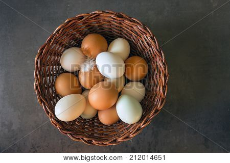 Fresh eggs in a wicker basket. Concept of organic products. Farm. Broken eggs with bright yolks.