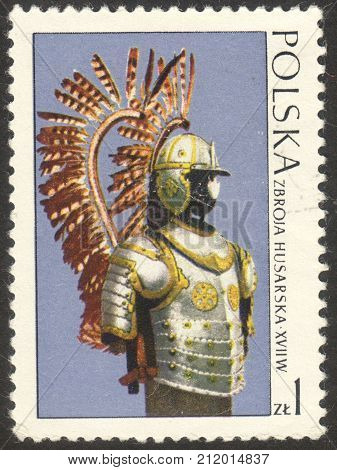 MOSCOW RUSSIA - CIRCA OCTOBER 2017: a post stamp printed in POLAND shows the Hussar's armor 16th century the series