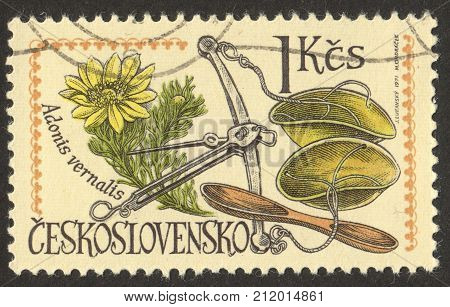 MOSCOW RUSSIA - CIRCA OCTOBER 2017: a stamp printed in CZECHOSLOVAKIA shows Scales and adonis vernalis the series