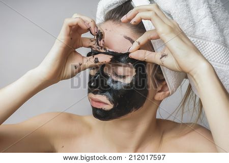 Woman remove black mask,good results. Face scrub,exfoliation pores,clean skin