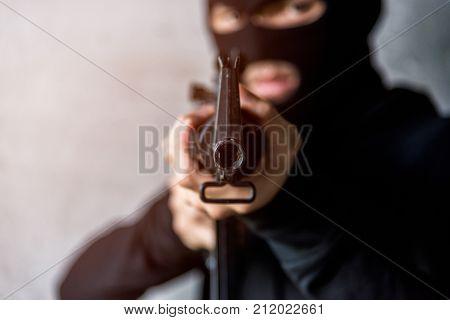 Young Gunman killer was aiming his M16 gun focus at gun tip