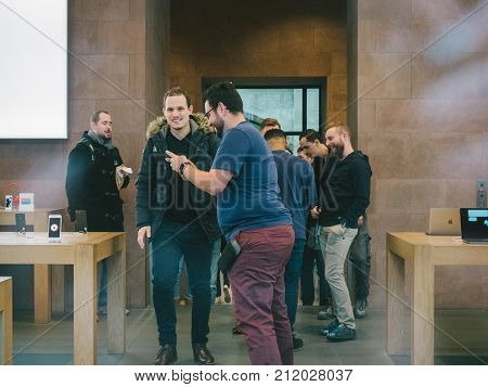 STRASBOURG FRANCE - NOV 3 2017: Customers entering in Apple store to pick the pre-order of the latest Apple iPhone X
