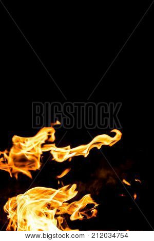 Fire flames at night fire is very hot and warm. Beautiful of Fire flames on black background abstract fire All Movement Blurred intention out of focus and high low exposure contrast