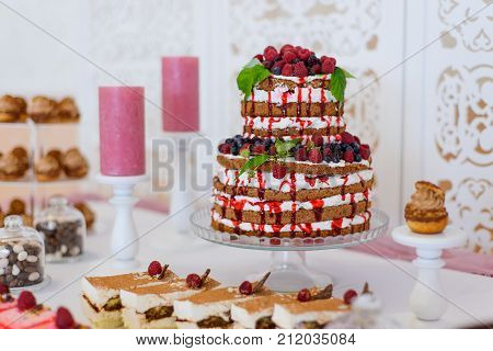 A Feast Of Cakes Served On The Buffet.sweet Desserts With Berries And Fruit Served On The Buffet.fru