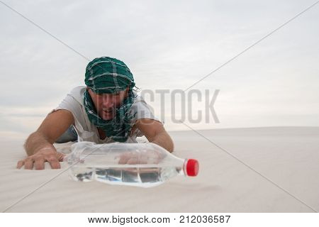 Exhausted Traveler Reaching For A Bottle Of Water