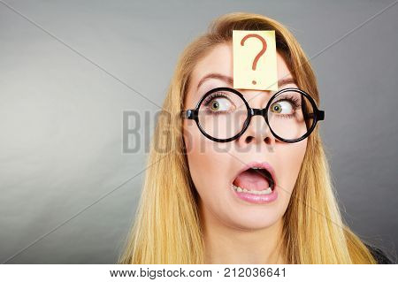 Weirdo Nerd Woman Having Question Mark On Forehead